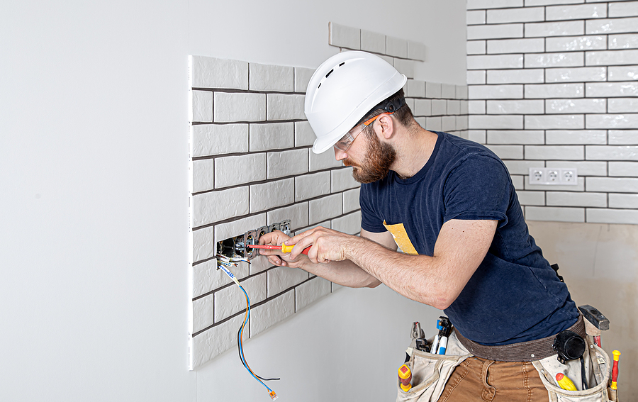 Electrician while installing sockets and switches