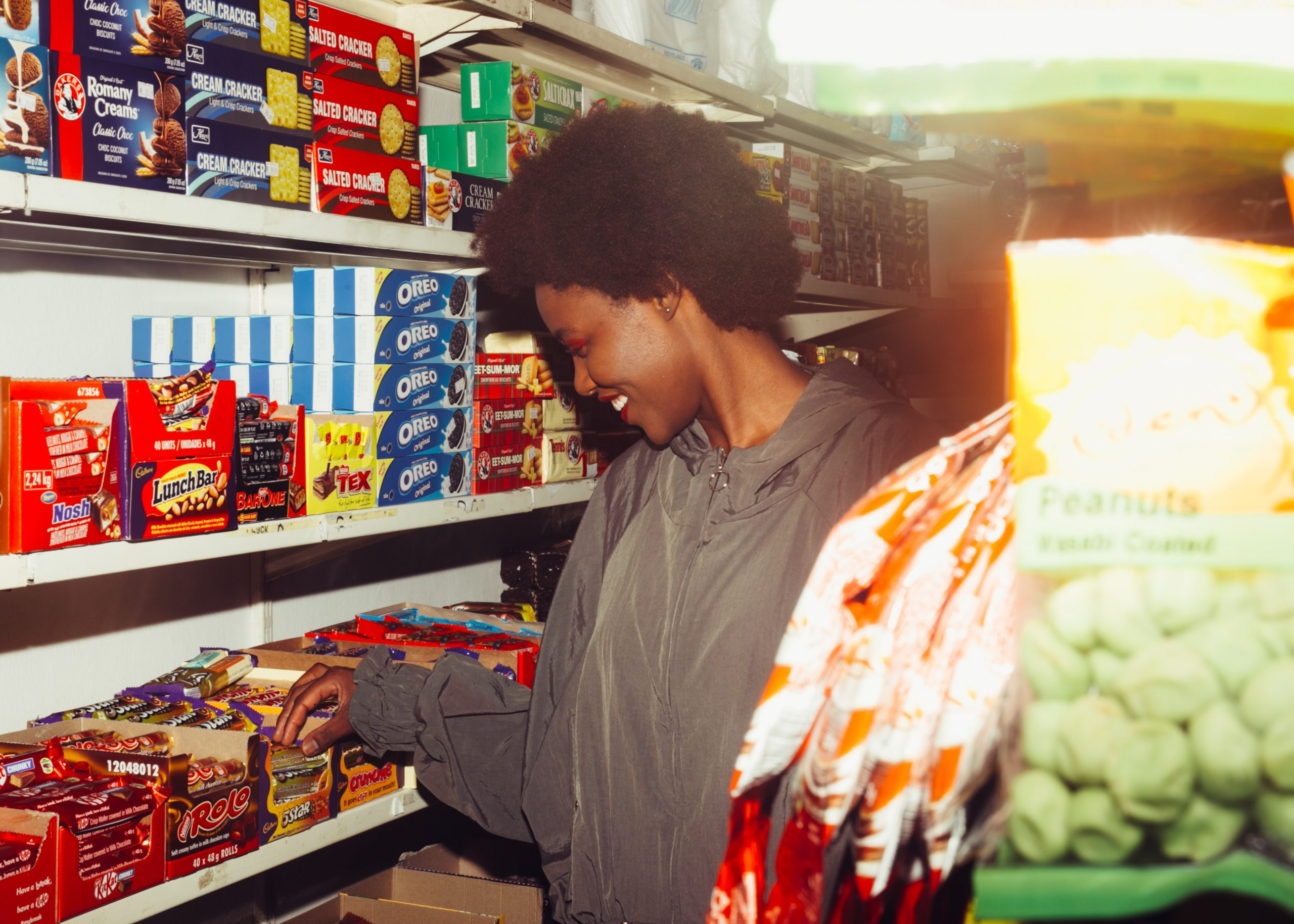 Woman inside a store that sells British candy